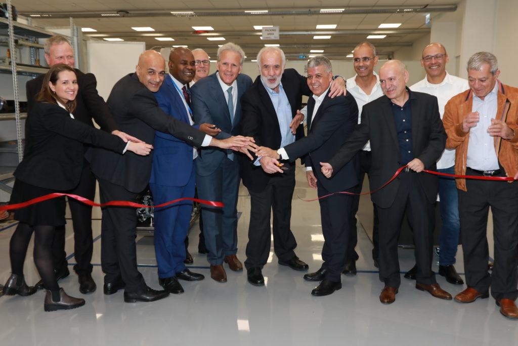Investors Honorary guests and GenCell management cut ribbon