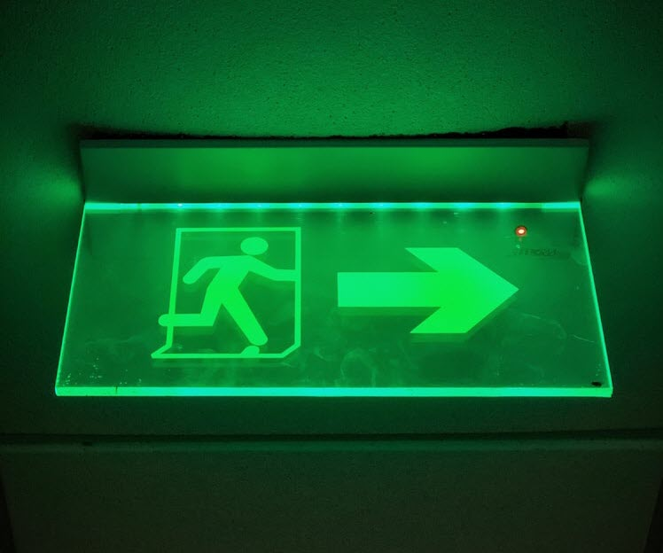 An emergency exit escape sign in green1