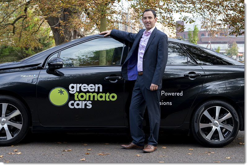 Jonny Goldstone CEO of Green Tomato Cars with a hydrogen powered Toyota Mirai